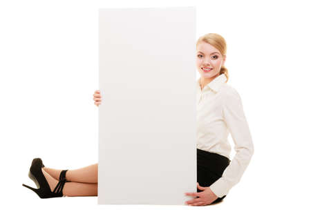 recommending: Advertisement. Young woman showing blank copy space banner isolated on white. Businesswoman recommending your product.