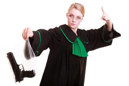 evidence bag: Law court or justice concept. Emotional woman polish lawyer attorney holding weapon gun - bag marked evidence of crime,  wagging her finger.  Isolated on white background. Stock Photo