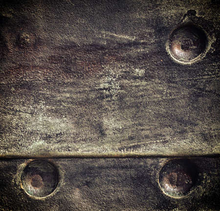 stell: Closeup of grunge black metal plate with rivets and screws as background or texture. Square format. Stock Photo