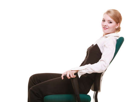 Break from work. Young businesswoman happy girl relaxing on chair isolated on white. Copy space. Business. photo