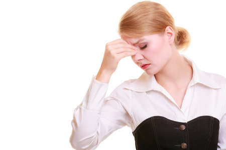 Headache, migraine and sinus ache. Stressed businesswoman worried young woman suffering from head or nose pain isolated on white. Stock Photo