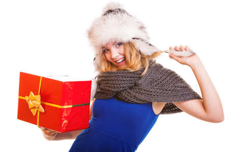 Christmas holidays valentines day, celebration and happy people concept - blonde girl in winter fur hat with red gift box present isolated photo