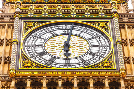 Closeup clock tower Big Ben Palace of Westminster, London England UK. photo