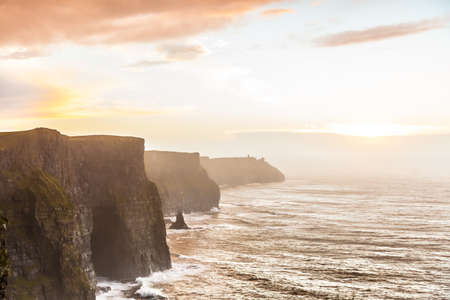 cliffs: Famous cliffs of Moher at sunset in Co. Clare Ireland Europe. Beautiful landscape as natural attraction. Stock Photo