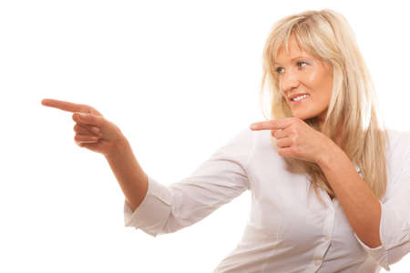 hint: Advertisement concept - mature business woman pointing with finger showing blank copy space isolated on white background Stock Photo