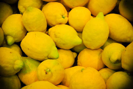 product healthy: food background. closeup on yellow citrus tropical fruits lemons. healthy product in store Archivio Fotografico