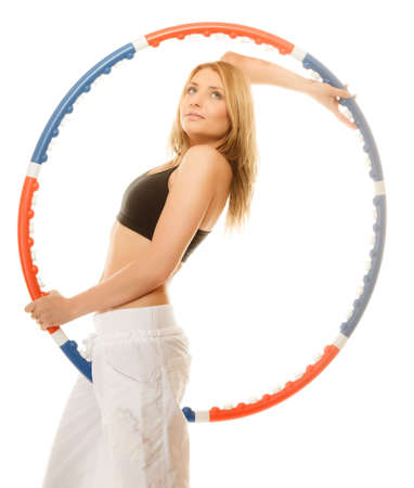 Sport training gym and lifestyle concept. Sporty girl doing exercise with hoop. Fitness woman isolated on white photo
