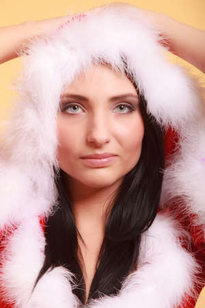 Portrait beautiful woman wearing santa claus costume clothes on yellow background photo