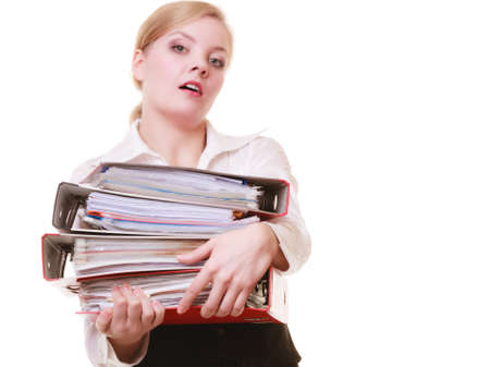 Business and paperwork. Tired overworked busy businesswoman carrying stack of folders with files documents isolated on white. photo