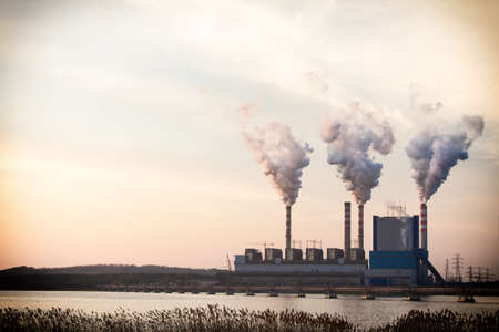 Energy. Smoke from chimney of power plant or station. Industrial landscape. Archivio Fotografico