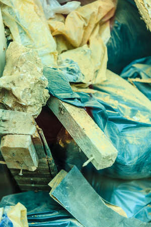 demolished house: Construction site. Stack of old grunge destroyed damaged bricks and material from demolished house . Industry. Stock Photo