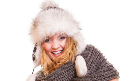 Winter fashion. Portrait positive teen girl in warm clothes. Happy young woman in fur hat doing fun isolated. photo