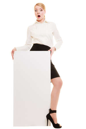 Advertisement. Surprised young woman holding blank copy space banner isolated on white. Businesswoman recommending your product. photo