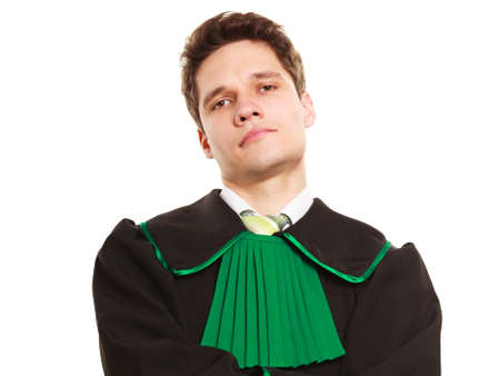 legality: Law court and justice. Portrait of young man lawyer attorney in polish (Poland) black green gown isolated on white. Occupation. Stock Photo