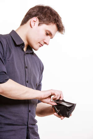 spending money: Finance and economy. Young man with wallet paying by credit card spending money. Buy and retail sell. Isolated on white. Studio shot.