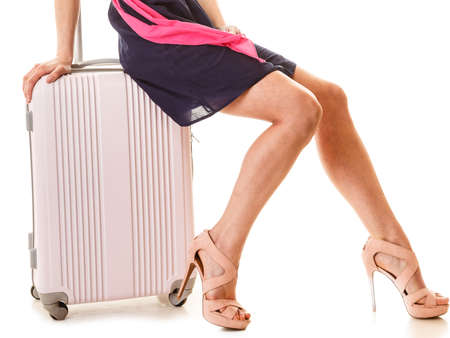 suitcase packing: Travel vacation concept. summer fashion woman in voyage, female legs and pink suitcase luggage bag. Stock Photo