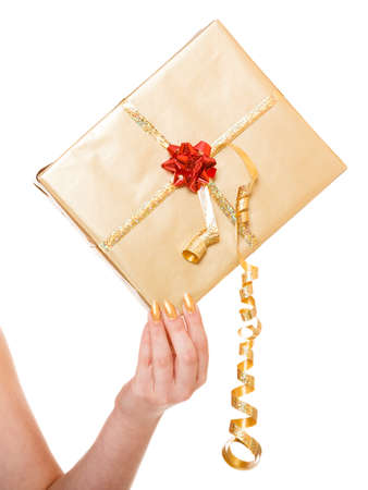 Christmas x-mas winter or valentines day, birthday concept - golden gift box in female hand isolated photo