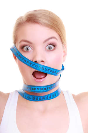 obsessed: Time for diet slimming weight loss. Health care healthy lifestyle. Fit fitness woman with violet measure tapes around her head. Obsessed girl by body isolated Stock Photo