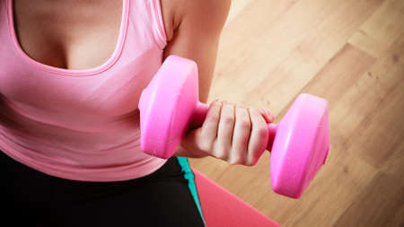 dumbbell: Fitness girl fit woman with dumbbells, doing exercise with dumb bells training with weights at home