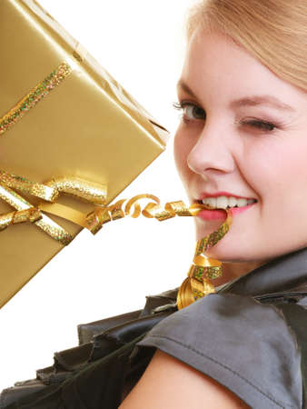 Holidays love and happiness concept - beautiful blonde girl with golden gift box isolated photo