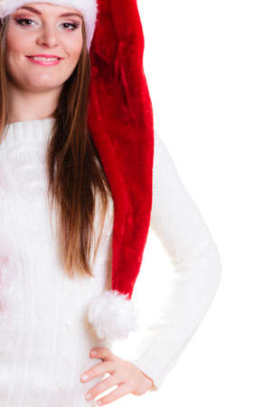 santa helper: Christmas winter happiness concept. Woman wearing santa helper hat portrait isolated on white