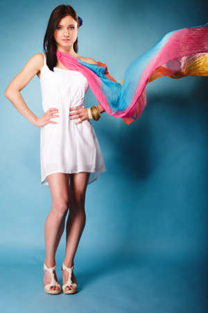 woman fashionable: Summer fashion. Full length beauty young woman fashionable sensual girl with multicolored flying shawl on blue