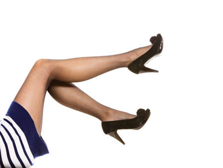 silky lingerie: Beautiful long woman legs in nice black pantyhose high heels isolated on white  Stock Photo