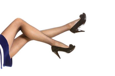 belles jambes: De belles jambes longues femme à Nice collants noir talons hauts isolé sur blanc