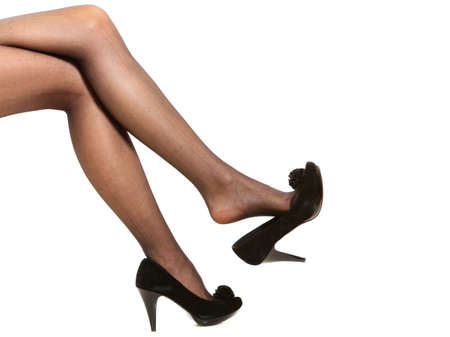 Beautiful long woman legs in nice black pantyhose high heels isolated on white  Stock Photo