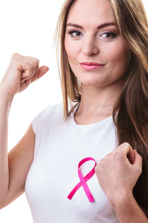 fighting cancer: Healthcare, medicine and breast cancer awareness concept - woman in t-shirt with pink cancer ribbon fighting  isolated