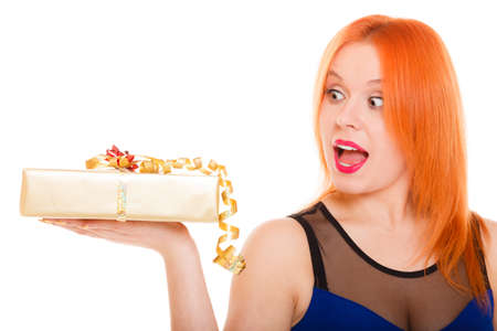 wide eyed: red hair wide eyed girl holding golden gift box