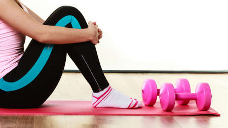 dumb bells: Fitness girl fit woman sitting on exercise mat with dumbbells, doing exercise with dumb bells training isolated