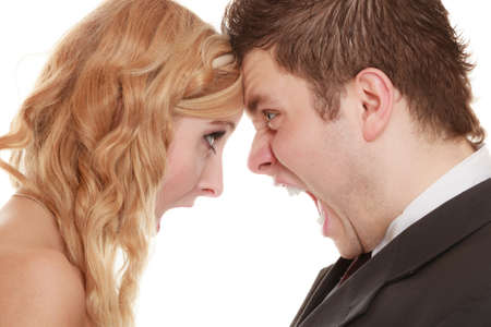 fury: Wedding couple relationship difficulties. Angry woman man yelling at each other. Portrait fury bride groom. Face to face. Negative bad communication human emotions facial expression.