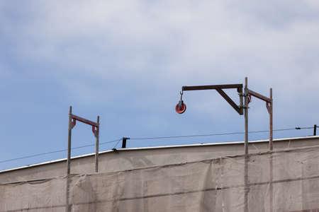 building activity: Building activity. Construction site with crane industrial equipment. Exterior.