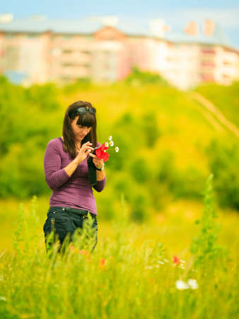 call of nature: Woman walking in city park, texting using touching cell phone, reading sms on smartphone. Technology