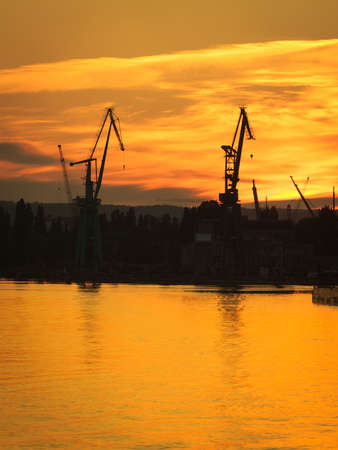 Big shipyard crane at sunset in Gdansk, Poland. Industry view. photo