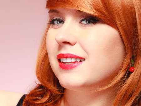 redhaired: Portrait beautiful young redhaired woman long hair on pink