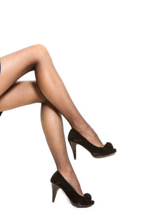 silky lingerie: Beautiful sexy long woman legs in nice black pantyhose high heels isolated on white background Stock Photo