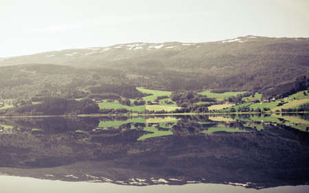 Tourism vacation and travel. Landscape and fjord in Norway, Scandinavia.  mountain reflections in water.