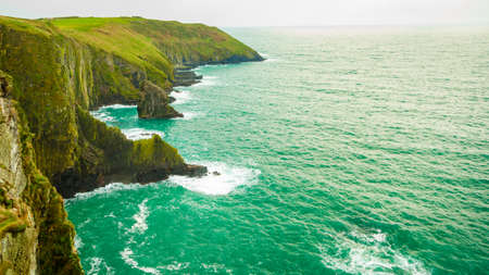 scenery: Irish landscape. Coastline atlantic ocean rocky coast scenery. County Cork, Ireland Europe. Beauty in nature.