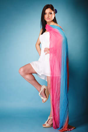 woman fashionable: Full length beauty young woman fashionable sensual girl with coloured shawl on blue background