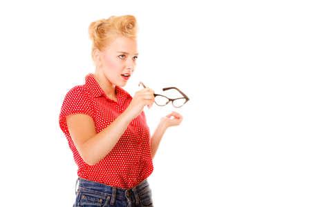 eyewear: Eyewear. Young blonde woman beautiful girl retro hairstyle holding glasses studio shot isolated on white Stock Photo