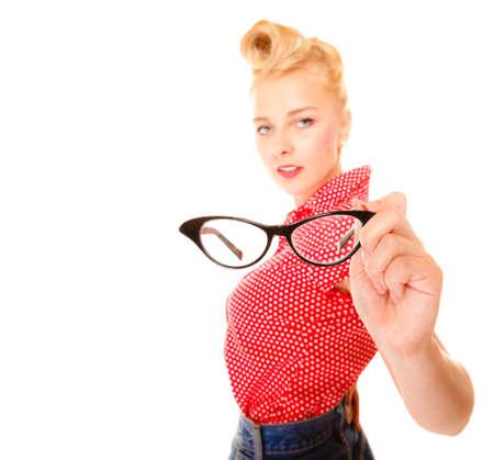 eyewear: Woman showing eyewear. Beautiful girl retro hairstyle holding glasses studio shot isolated on white