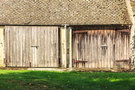 barn doors: The old wooden barn with two doors in the english rural countryside