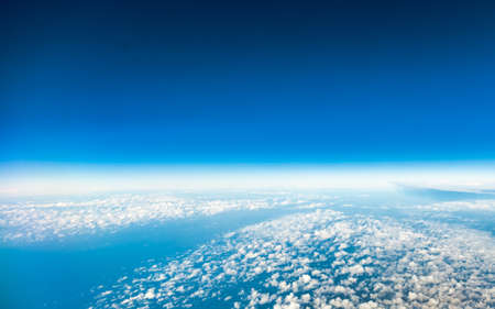 Blue sky. View from window of airplane flying in clouds. Skyscape cloudscape. Birds eye. photo