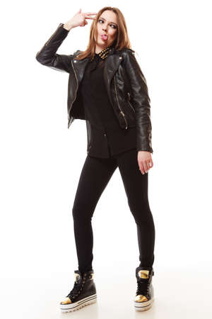 tenager: Young people teenage concept - Full length stylish young model teenager girl in casual style clothes making silly face Stock Photo