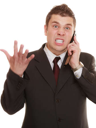 relationship difficulties. Angry man talking on mobile cell phone. Fury businessman screaming, negative facial expression isolated on white.