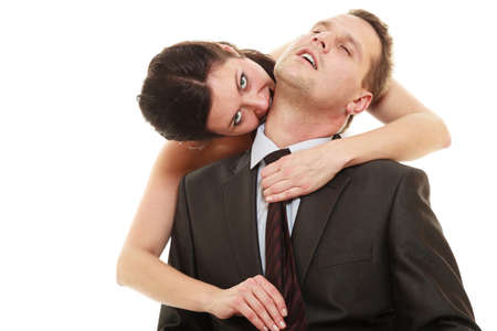emancipation: Emancipation. Woman pulling tie of man, wife showing her domination over husband isolated on white. Stock Photo