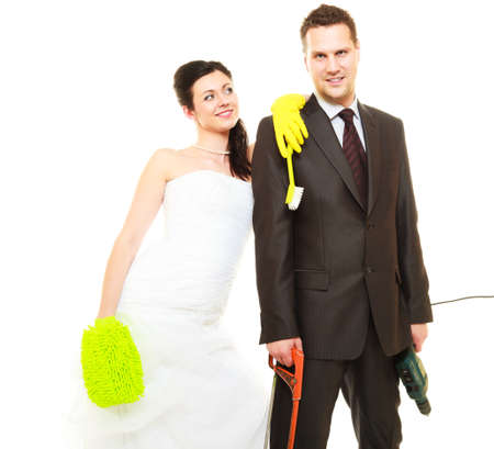 role: Housework concept. Humorous funny couple bride groom in domestic role, sharing household chores. Isolated on white background.