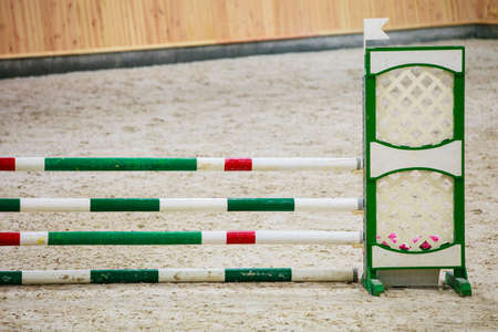 equitation: Equitation. Green red white obstacle for jumping horses. Riding competition. Real.